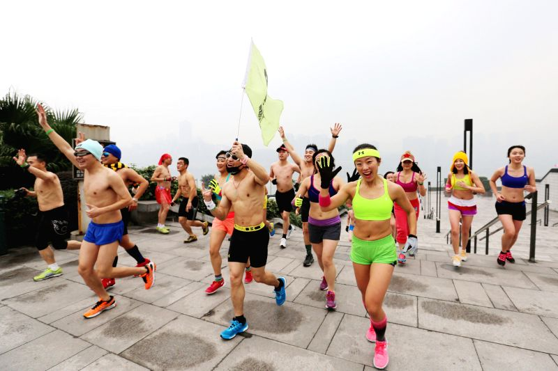 Participants wearing underwear take part in a running campaign to greet the upcoming winter solstice in Chongqing, southwest China, Dec. 21, 2014. The winter ...