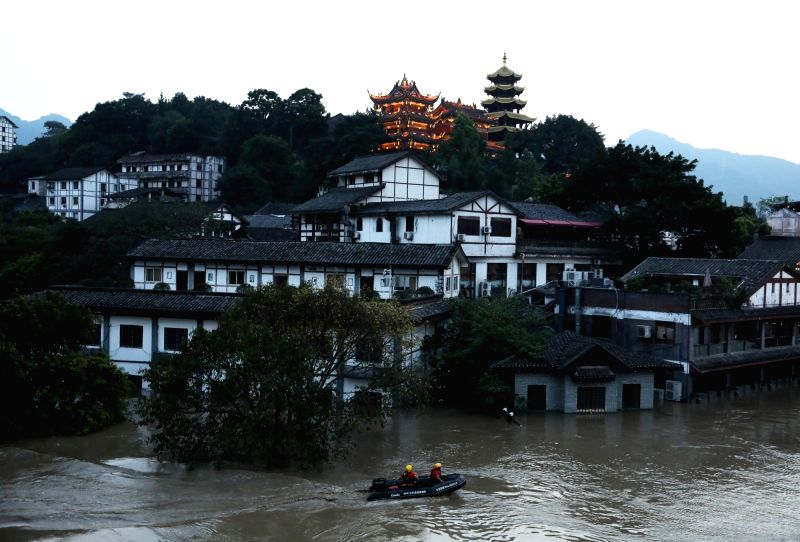 CHONGQING, July 14, 2018 - Workers of flood control department patrol in Jialing River at Ciqikou, an ancient township in Chongqing Municipality, southwest China, July 13, 2018. Heavy rain continues ...