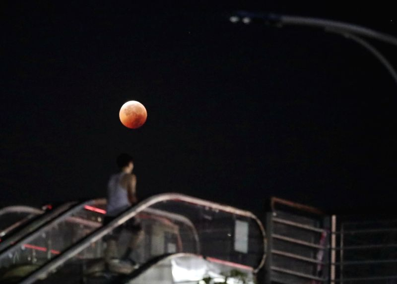 CHONGQING, July 28, 2018 - The moon is seen during a lunar eclipse in Chongqing, southwest China, July 28, 2018. It is believed to be the longest lunar eclipse of the century.