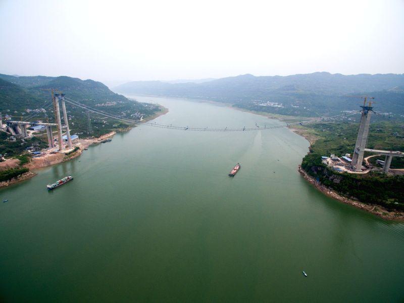 CHONGQING, May 6, 2016 - An aerial photo taken on May 4, 2016 shows the Fuma Yangtze River Bridge, which is under construction, in Wanzhou of Chongqing, southwest China. The Fuma Yangtze River ...