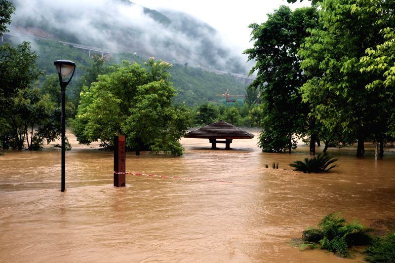 A road is flooded in Wuxi County, southwest China's Chongqing Municipality, Sept. 1, 2014. Affected by a rain-triggered flood starting from Aug. 31, the ...
