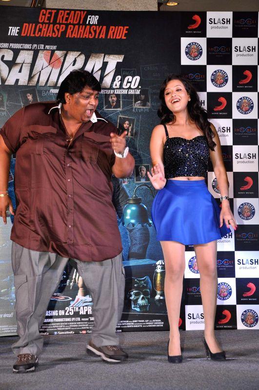 Choreograoher Ganesh Acharya and Madalasa Sharma during the music launch of film Samrat & Co in Mumbai on April 11, 2014. - Madalasa Sharma