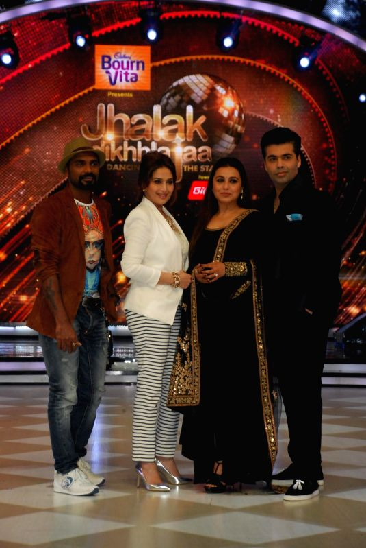 Choreographer Remo D`Souza, actors Madhuri Dixit, Rani Mukerji and filmmaker Karan Johar on the sets of Jhalak Dikhhla Jaa 7 during the promotion of film Mardaani in Mumbai on July 22, 2014. (Photo : - Madhuri Dixit, Rani Mukerji and Karan Johar