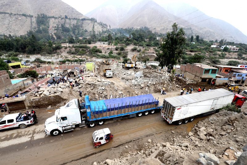 Vehicles move during the cleaning works of the Central Highway after a landslides in Chosica district of Lima, Peru, on March 29, 2015. At least nine people were ...