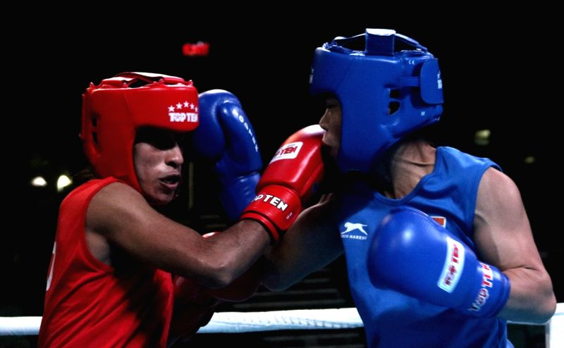 Choudhary Varsha (Red) and M C Mary Kom (Blue) of India in action during the 1st India Open international boxing tournament in New Delhi, on Jan 28, 2018. - Mary Kom