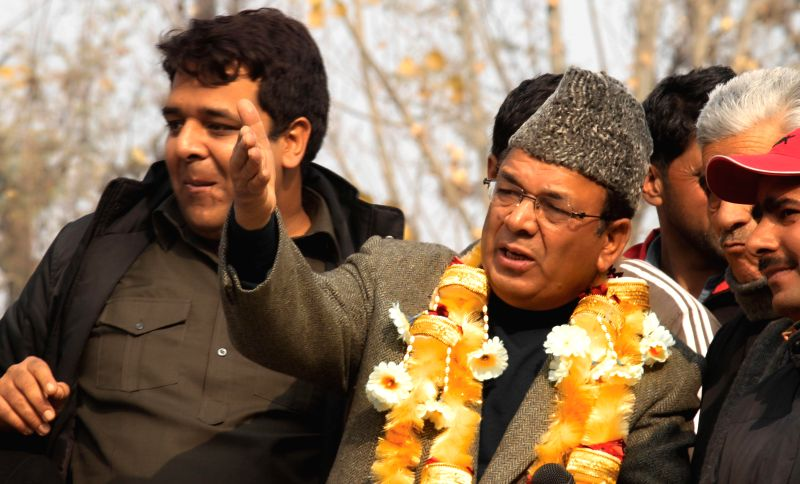 Chrar-e-Sharif : National Conference leader Abdul Rahim Rather during an election campaign ahead of Jammu and Kashmir Assembly Polls in Chrar-e-Sharif of Badgam district on Nov 24, 2014.