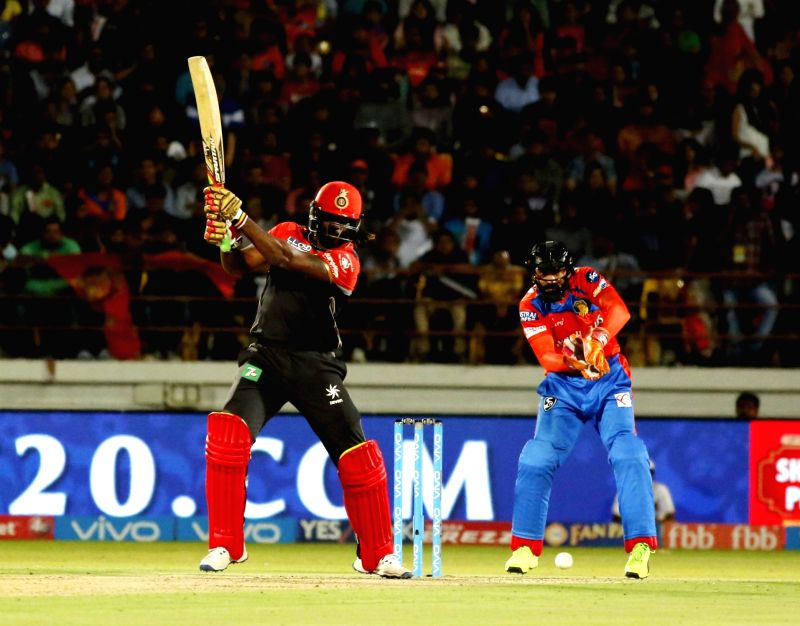 Chris Gayle of Royal Challengers Bangalore in action during an IPL 2017 match between Royal Challengers Bangalore and Gujarat Lions at Saurashtra Cricket Association Stadium in Rajkot on ...
