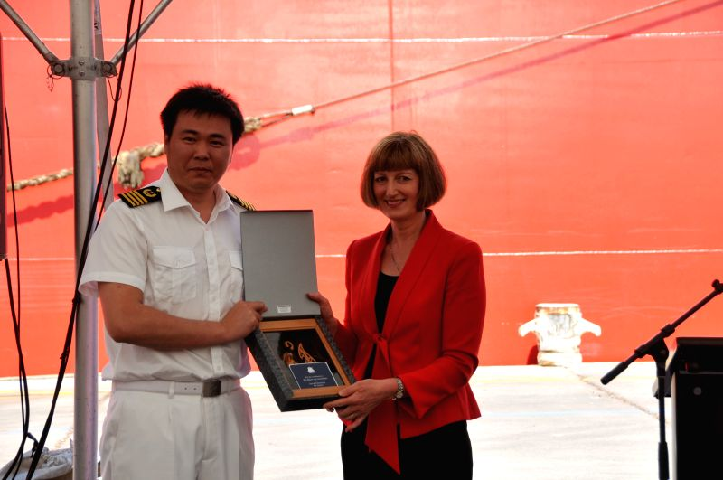 Chief Executive of Christchurch City Council Karleen Edwards (R) gives gifts to the Chinese icebreaker Xue Long in Christchurch, New Zealand, Jan. 17, 2015. ...