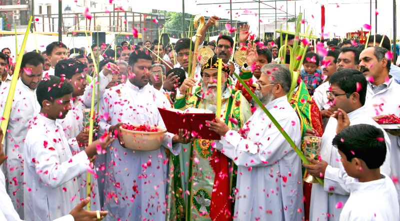 Christians during a gathering organised on 'Palm Sunday' at St Mary's Cathedral, Hauz Khas in New Delhi on April 13, 2014. Palm Sunday is a Christian feast that is observed on the Sunday before ...