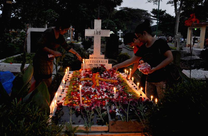 Christians observe All Souls Day  in Kolkata, on Nov 2, 2015.