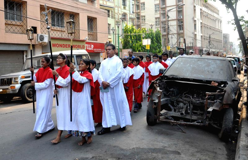 Christians participate in a procession organised on Good Friday in Kolkata on April 18, 2014.