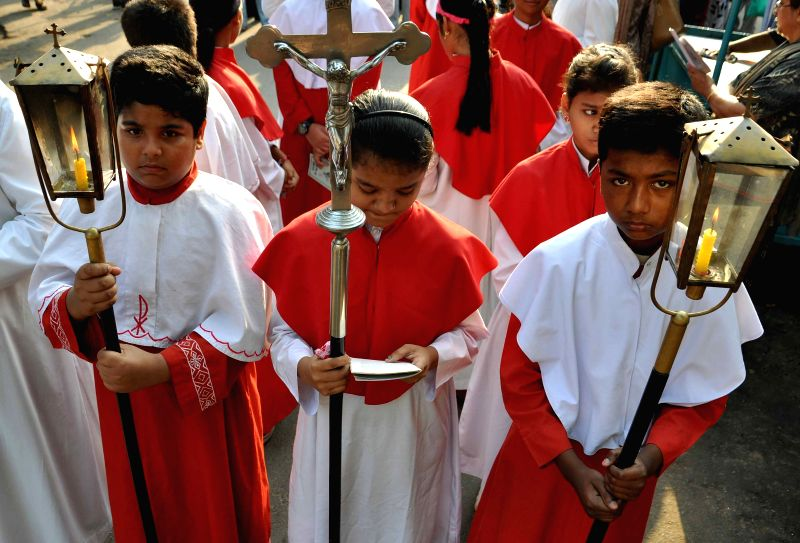 Christians participate in a procession organised on Good Friday in Kolkata, on April 3, 2015.