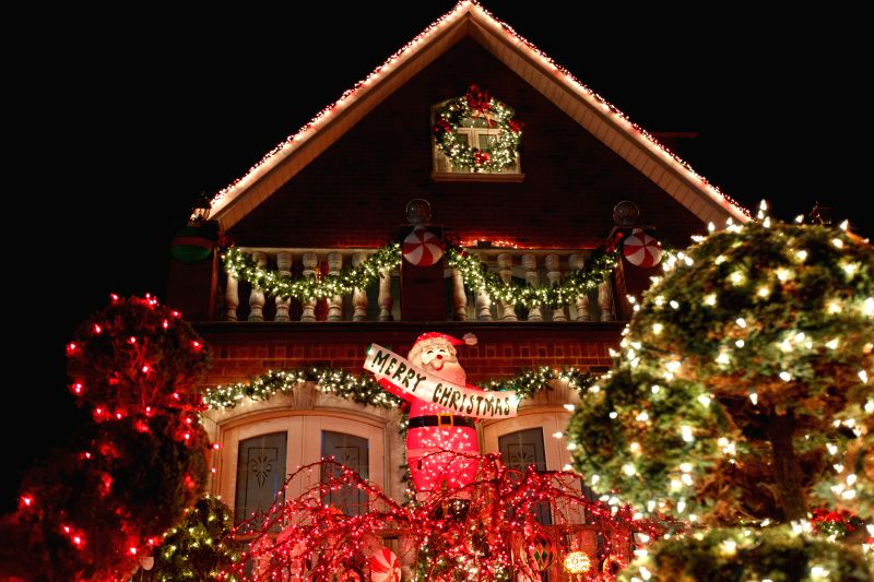 Christmas decorators and lights are seen in Dyker Heights, Brooklyn, New York.