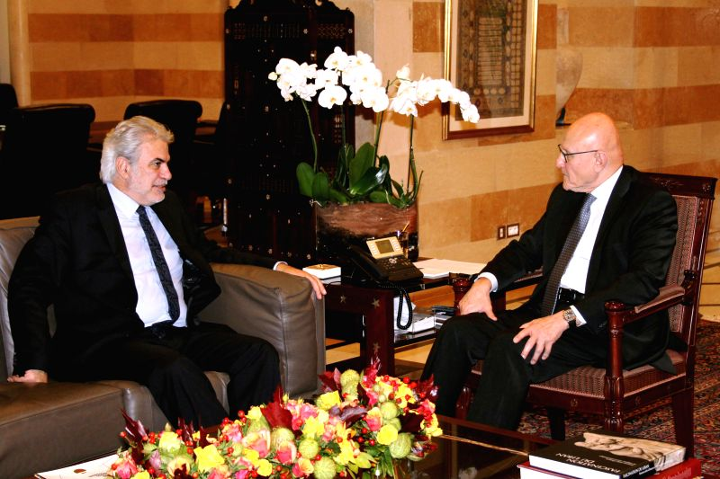 Christos Stylianides (L), the visiting European commissioner for Humanitarian Aid and Crisis Management, meets with Lebanese Prime Minister Tammam Salam, in Beirut, ... - Tammam Salam