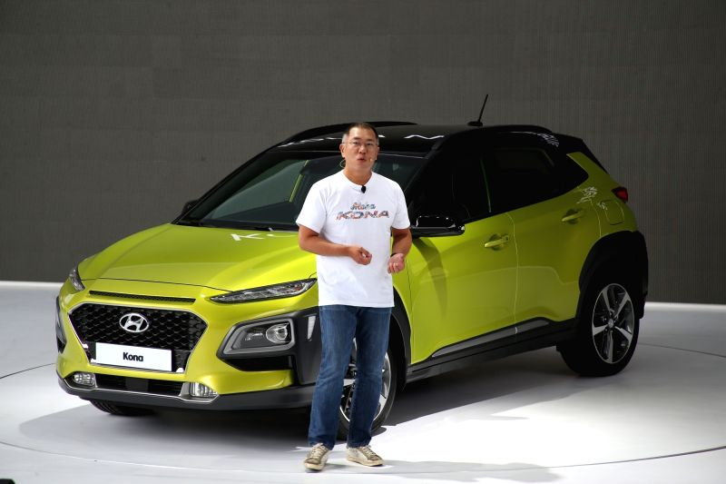 Chung Eui-sun, vice chairman of Hyundai Motor Co., presents the company's new subcompact sport utility vehicle Kona at its world premier from the Hyundai Motor Studio in Goyang, north of Seoul, on ...