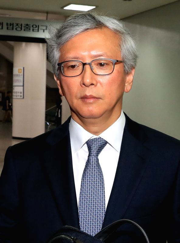 Chung Kee-yang, a medical doctor at Yonsei University, arrives at the Seoul Central District Court on May 18, 2017. The court sentenced Chung to one year in prison for perjury. Chung is accused of ...