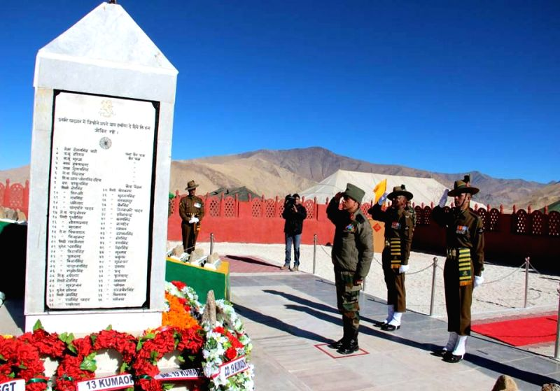 Soldiers pay tribute to martyrs during a programme organised to commemorate the 52nd Anniversary of the Battle of Rezang  La in Chushul, Ladakh of Jammu and Kashmir on Nov 18, 2014.