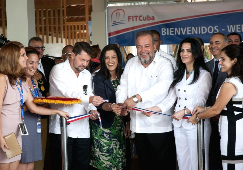 "Cuban Tourism Minister Manuel Marrero (3rd R) cuts the ribbon of the 35th edition of the International Tourism Fair ""FITCuba 2015"", in Jardines del ... - Manuel Marrero"