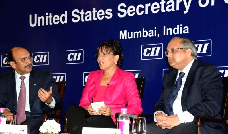 CII President Ajay Shriram and CII, Director General Chandrajit Banerjee with US Commerce Secretary Penny Pritzker during a programme in Mumbai on on July 30, 2014. - Chandrajit Banerjee