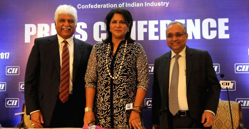 CII President Shobana Kamineni with CII Vice President Rakesh Bharti Mittal and CII Director General Chandrajit Banerjee during a press conference in New Delhi on May 4, 2017. - Chandrajit Banerjee