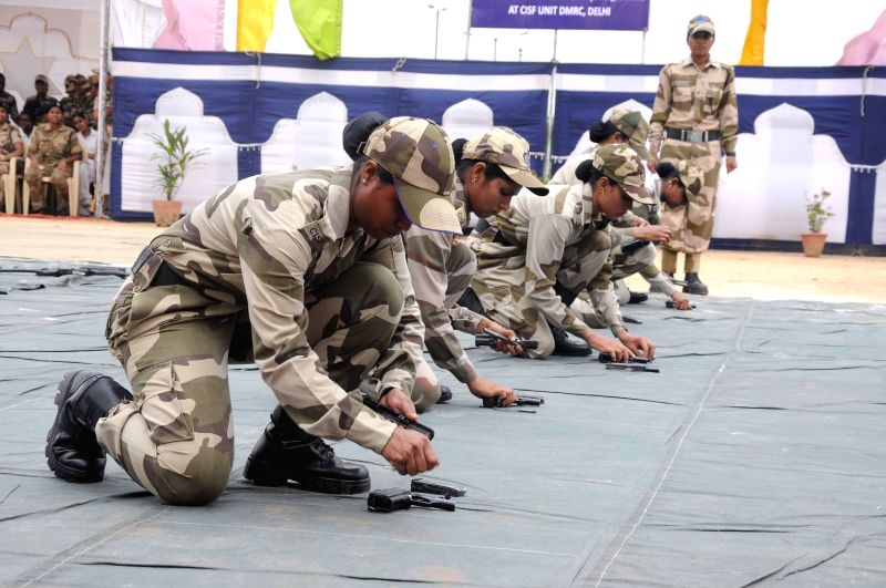 CISF personnel demonstrate their skills during the `CISF Women's Self Defence Programme` at Shastri Park in New Delhi on August 1, 2014.