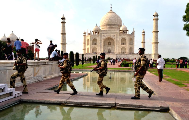 CISF personnel personnel patrol Taj Mahal in Agra on Aug 14, 2014.