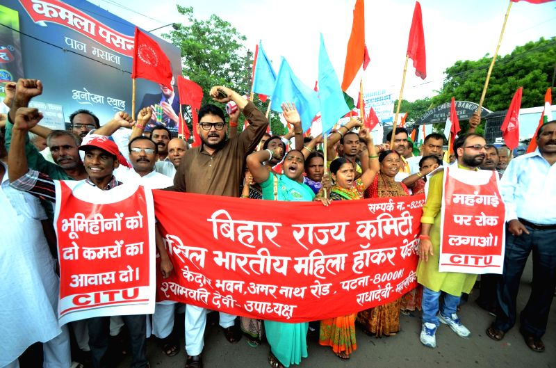 CITU activists stage a demonstration against hike in prices of essential commodities in Patna, on Aug 9, 2016.