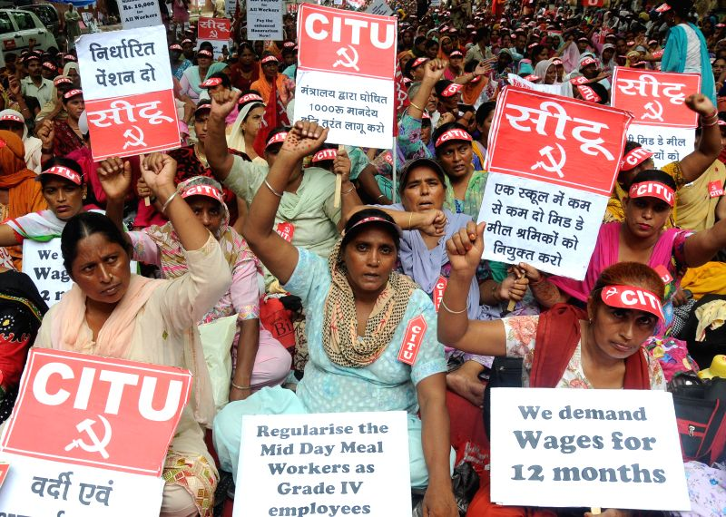 CITU affiliated mid-day meal workers stage a demonstration to press for their demands at Jantar Mantar in New Delhi on Aug 5, 2014.