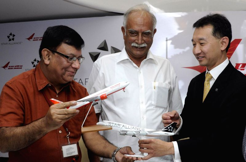 Civil Aviation Minister Ashok Gajapathi Raju Pusapati with Rohit Nandan, CMD, Air India (left) and Jeffrey Goh, COO, Star Alliance (Right) during a press conference after Air India joined Star ... - Ashok Gajapathi Raju Pusapati