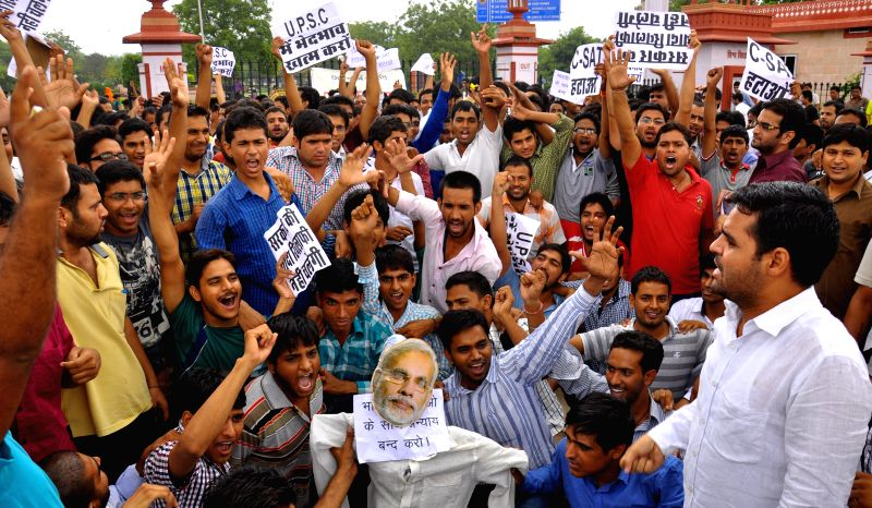 Civil service aspirants demonstrate to press for scrapping of Civil Services Aptitude Test (CSAT) outside Rajasthan University in Jaipur on Aug 7, 2014.