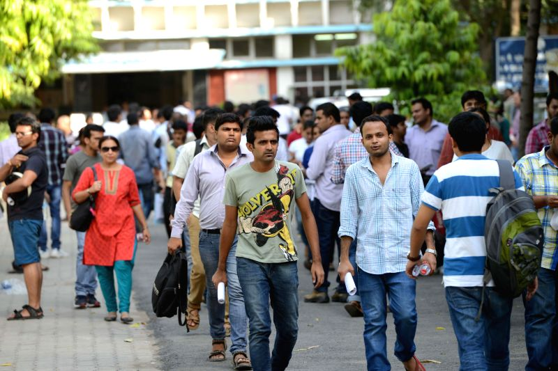 Civil Service aspirants leave exam centres after appearing in Civil Services Aptitude Test (CSAT) in New Delhi on Aug 24, 2014.