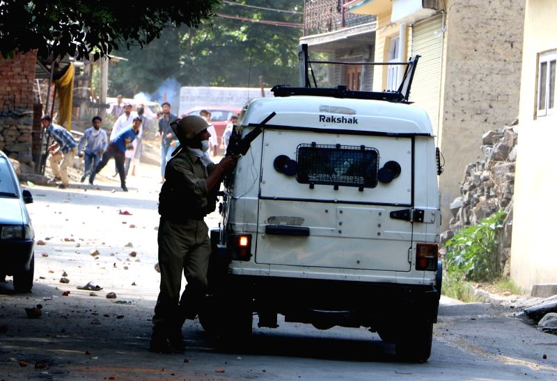 Clashes erupt between locals and security forces outside the UN office in Srinagar on July 29, 2016.