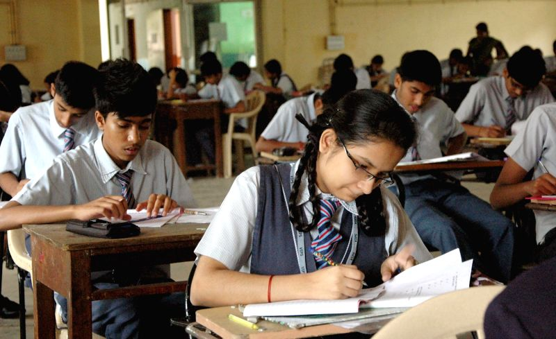 Students of CBSE schools busy solving their mathematics paper during board examination
