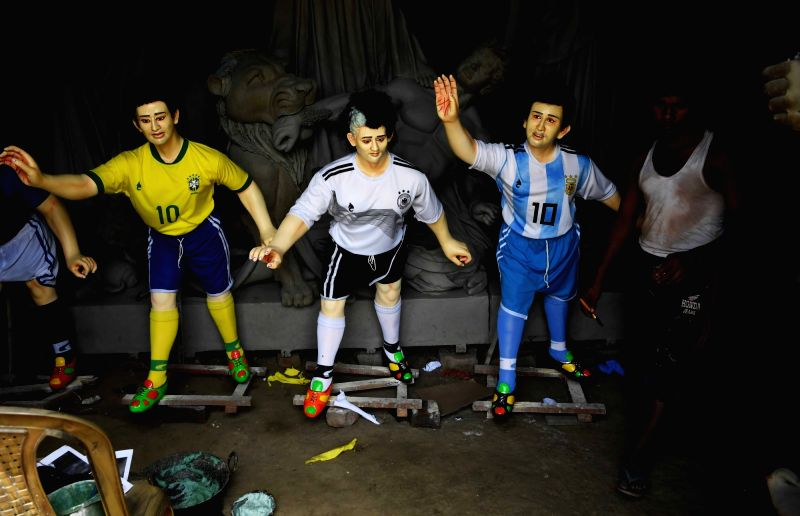 Clay models of footballers participating in upcoming FIFA World Cup in Kolkata, on June 13, 2018.