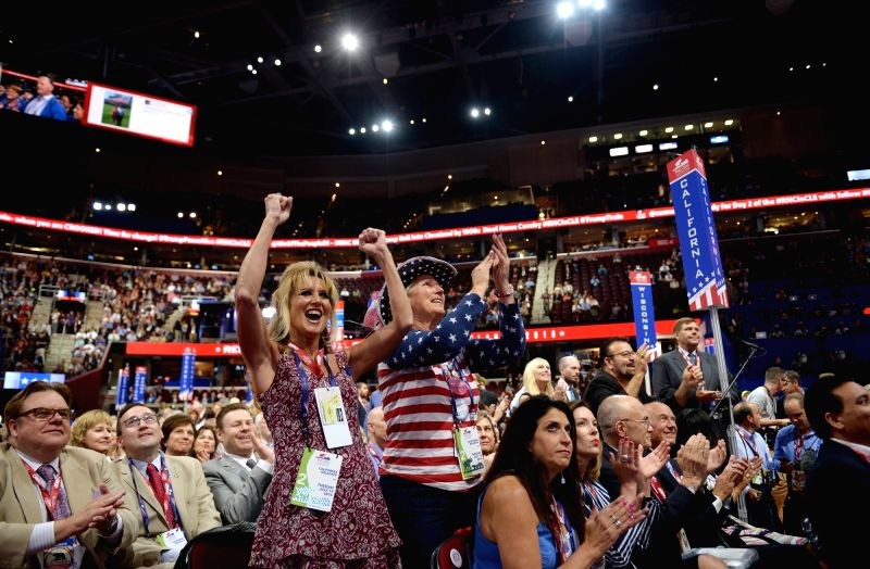 CLEVELAND, July 20, 2016 - Delegates supporting Donald Trump cheer on the second day of the Republican National Convention in Cleveland, Ohio, the United States, July 19, 2016. New York billionaire ...