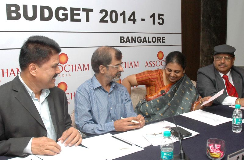 Co-Chairman of ASSOCHAM's southern regional council, J Crasta and Director General of Income Tax (Investigation) for Karnataka and Goa, S K Misra during a seminar on Union Budget 2014-15 in Bangalore