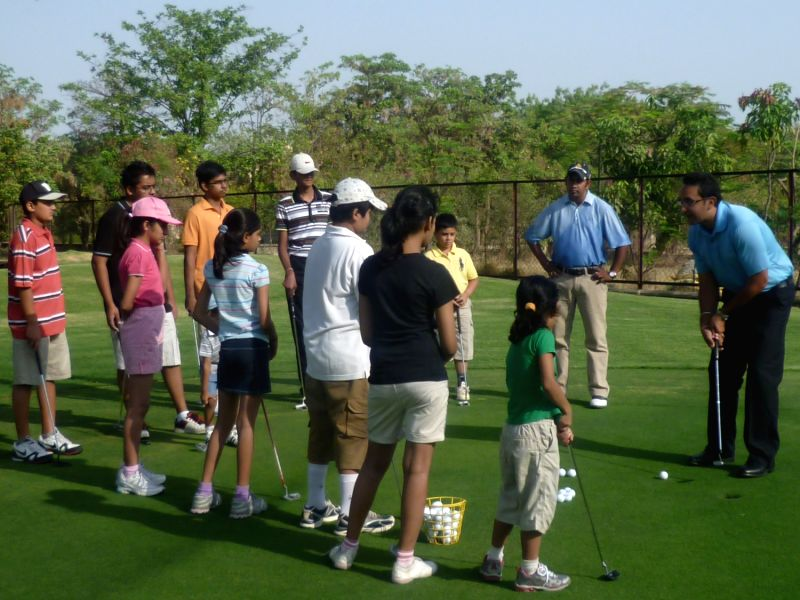 Coach Jasjit Singh teaches the rudiments of putting to eager golfing enthusiasts at the Delhi Golf Club. - Jasjit Singh