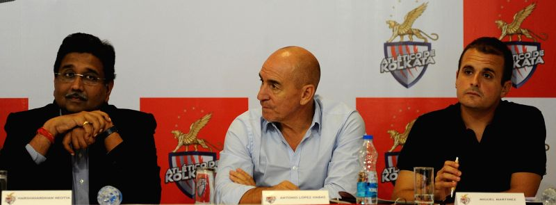 Coach of Atletico de Kolkata, Antonio Lopez Habas, assistant coach of the team Miguel Martinez and Harshavardhan Neotia during a press conference in Kolkata on Aug 22, 2014.