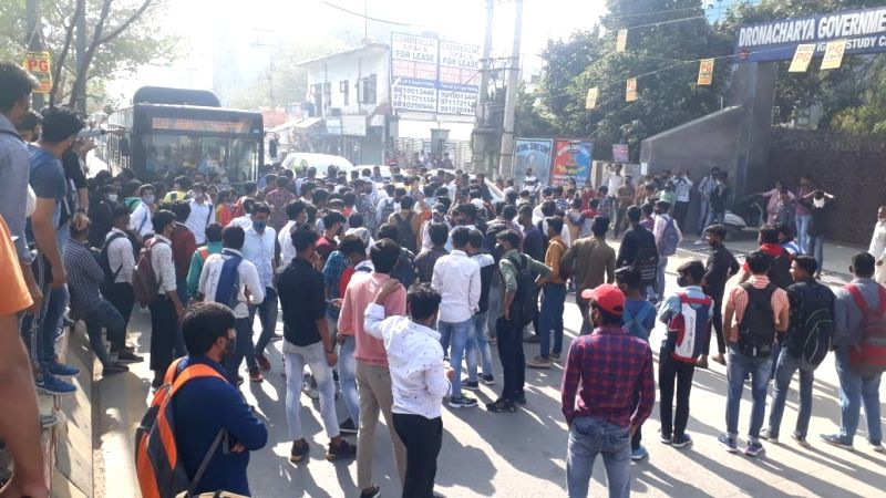 College students protest, block road, boycott classes demanding online examination