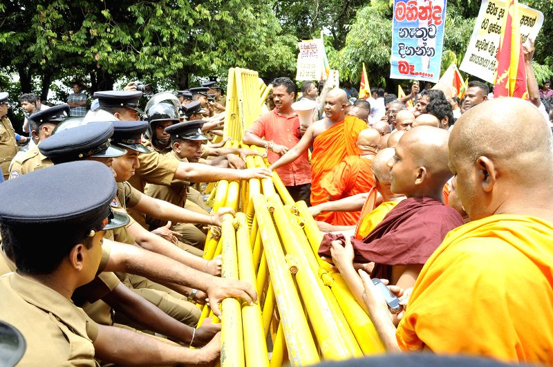 People participate in a protest against bribery investigation of the former president Mahinda Rajapakse in Colombo, Sri Lanka, on April 21, 2015. Thousands of ...