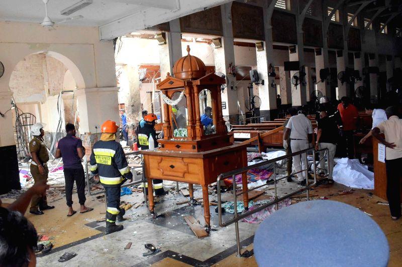 People work at a blast scene at St. Anthony's Church in Kochchikade in Colombo, Sri Lanka, April 21, 2019.