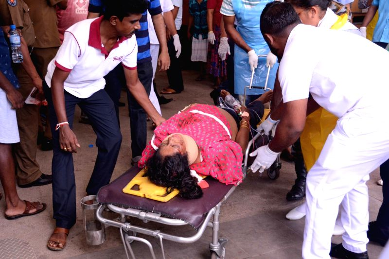 Colombo, April 22, 2019 (Xinhua) -- An injured woman is carried on a stretcher in a hospital in Negombo, north of Colombo, Sri Lanka, April 21, 2019. Sri Lankan Police said on Sunday that 13 people had been arrested over a series of blasts which kill