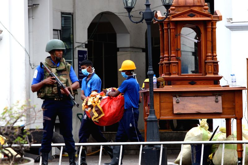 COLOMBO, April 27, 2019 (Xinhua) -- Workers clear away debris and shattered glass amid tight security outside St. Anthony's Church, one of the targets in a series of bomb blasts targeting churches and luxury hotels on Sunday in Colombo, Sri Lanka, on