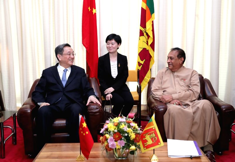COLOMBO, April 8, 2017 - Yu Zhengsheng (L), chairman of the National Committee of the Chinese People's Political Consultative Conference (CPPCC), holds talks with Sri Lankan Parliament Speaker Karu ... - Karu Jayasuriya