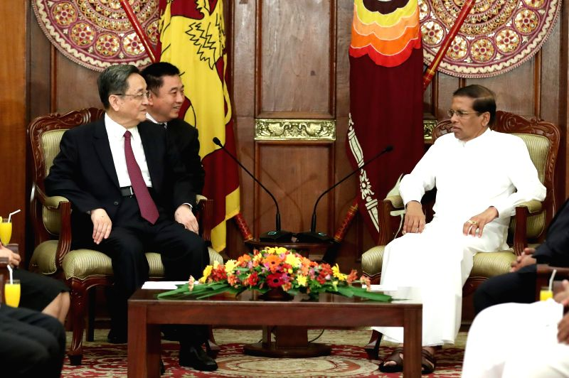 COLOMBO, April 8, 2017 - Yu Zhengsheng (L), chairman of the National Committee of the Chinese People's Political Consultative Conference (CPPCC), meets with Sri Lankan President Maithripala Sirisena ... - Karu Jayasuriya