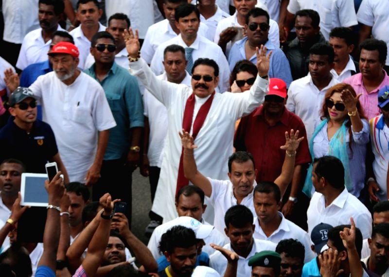 COLOMBO, Aug. 2, 2016 - Former Sri Lankan President Mahinda Rajapaksa (C) walks among his supporters during a rally in Colombo, Sri Lanka, Aug. 1, 2016. Opposition political parties and supporters of ...