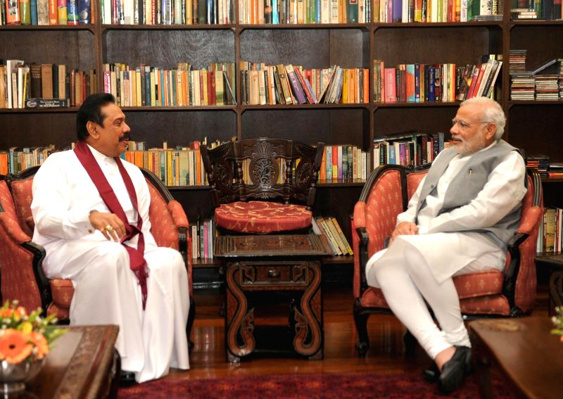 Former Sri Lanka president Mahinda Rajapaksa meets the Prime Minister Narendra Modi to discuss the development cooperation opportunities, in Colombo Sri Lanka on March 14, 2015. - Narendra Modi
