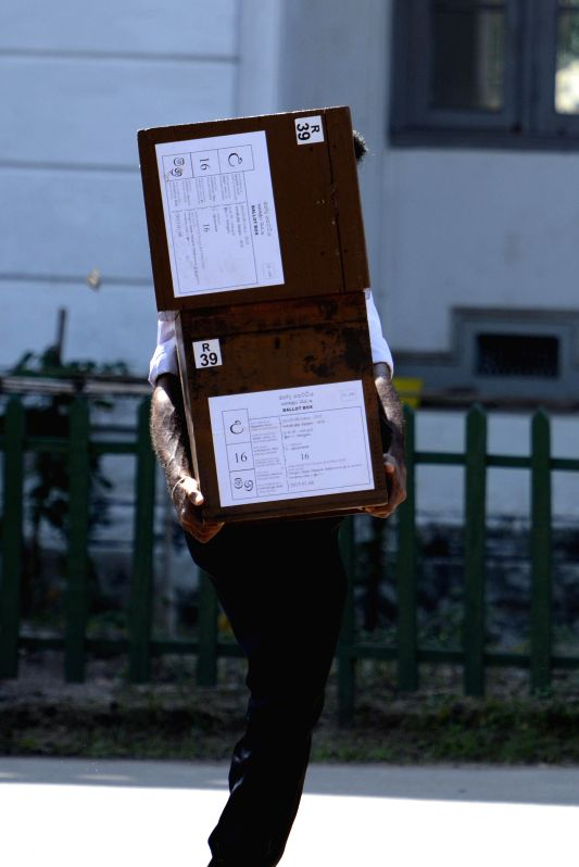 A Sri Lankan election worker carries ballot boxes in Colombo, Sri Lanka, on Jan. 7, 2015. Sri Lankans will go to the polls on Thursday as the incumbent president ... - Maithripala Sirisena