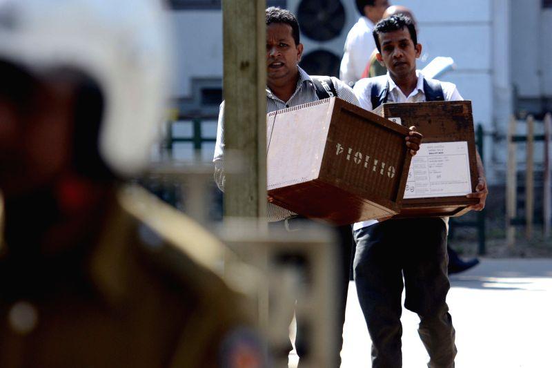 Sri Lankan election workers carry ballot boxes in Colombo, Sri Lanka, on Jan. 7, 2015. Sri Lankans will go to the polls on Thursday as the incumbent president ... - Maithripala Sirisena