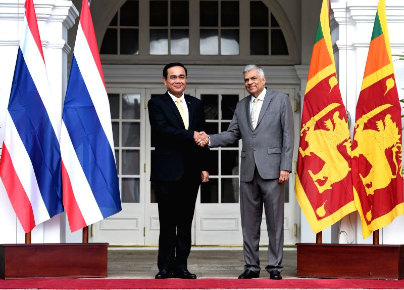 COLOMBO, July 13, 2018 - Sri Lankan Prime Minister Ranil Wickramasinghe (R) shakes hands with Thai Prime Minister Prayut Chan-o-cha during his visit at Prime Minister's Office, Colombo, Sri Lanka, on ... - Ranil Wickramasingh